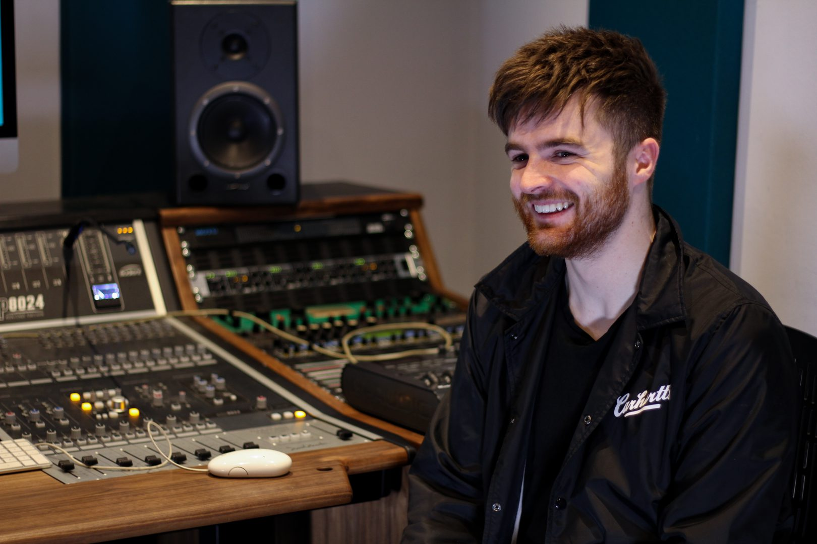 Jack smiles while talking with Aisling in our studio
